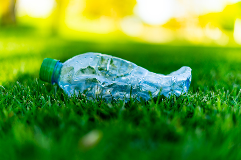 OSO environmental waste plastic recycling - waste plastic bottle on grass